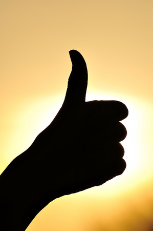 handsignal: Excellent hand sign silhouette. On bright sun background.