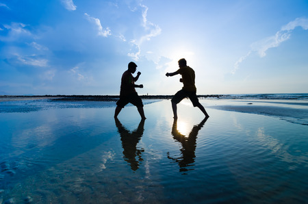 jiu jitsu: Fighting an enemy near the beach when the sun rising up