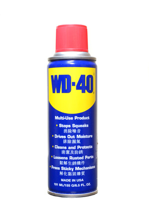 wetness: PAHANG, MY - JUNE 2, 2014: Can of WD 40 on a white