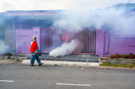 Pahang, Malaysia - November 22 : The unidentified officer is spraying chemical for an outbreak of dengue fever on November 22 , 2014 in Kuantan, Pahang, Malaysia.