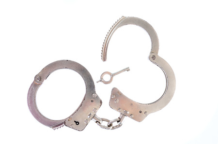Photo of a pair of handcuffs isolated on a white background photo