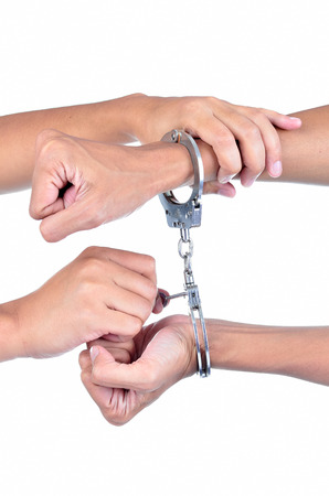 wristlets: Man hands with handcuffs got arrested isolated on white background