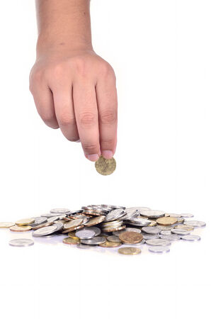 dropping: A male hand dropping coin isolated against a white background