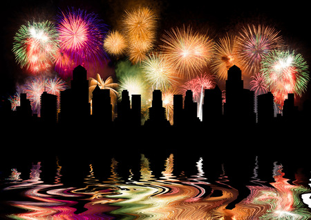 slight: Colorful fireworks. Fireworks are a class of explosive pyrotechnic devices used for aesthetic and entertainment purposes. Visible noise due to low light, soft focus, shallow DOF, slight motion blur Stock Photo