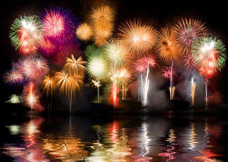 Colorful fireworks. Fireworks are a class of explosive pyrotechnic devices used for aesthetic and entertainment purposes. Visible noise due to low light, soft focus, shallow DOF, slight motion blur Stockfoto