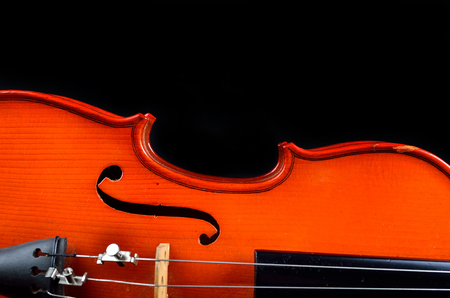 stradivarius: Vintage violin on black background