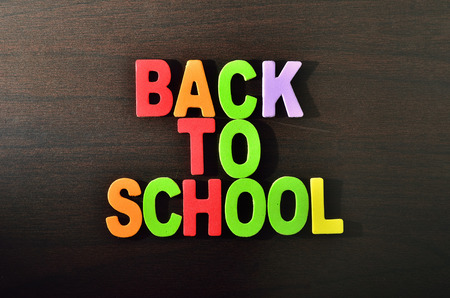 Back to School text with shadow on wooden background Stock Photo