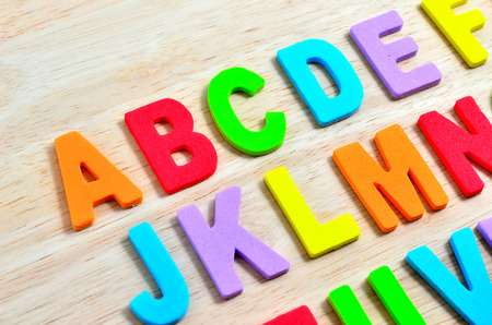 orthography: ABC alphabets on wooden background