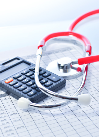 health care: Health care costs. Stethoscope and calculator symbol for health care costs or medical insurance