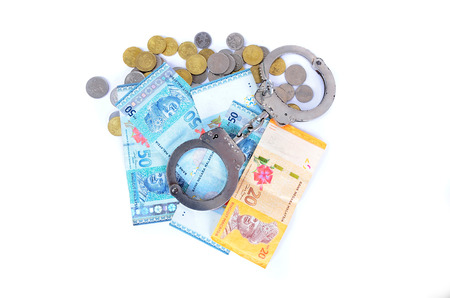 cash money: Cash money and handcuffs. the concept of crime and corruption