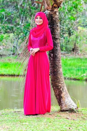 muslimah: Beautiful muslimah lady wear blouse and hijab posing at garden