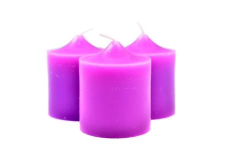 candlelit: Purple Candles isolated on white background Stock Photo