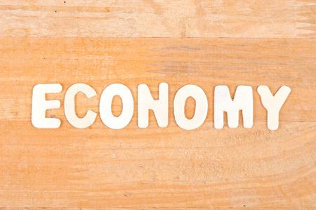 keywords background: Economy word on wood background Stock Photo