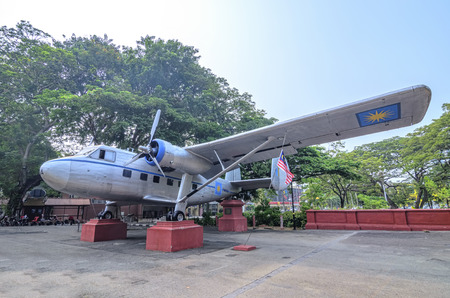 malaya: MALACCA, MALAYSIA - OCTOBER 19 : Visitors view historic aircraft on October 19, 2015 at Melaka, Malaysia. Airplane used by first Prime Minister of Malaysia in 1954 to seek independence for Malaya.