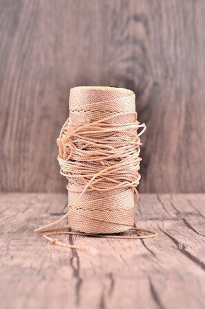 durable: Reel of durable thread on the wooden table Stock Photo