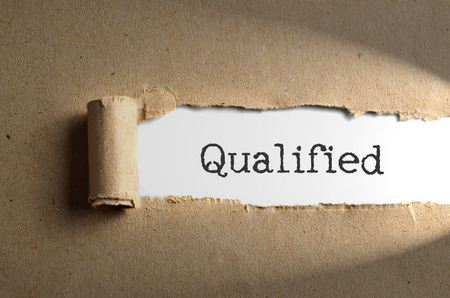 qualified: Torn paper with word Qualified