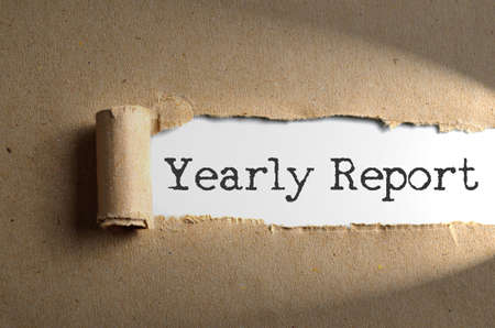 audit: Torn paper with word Yearly Report Stock Photo