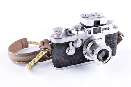 viewfinder vintage: MALACCA, MALAYSIA - NOVEMBER 7, 2015: Illustrative Editorial Photo of Leica Leitz Elmar 50mm F3.5, isolated on white background. Leica is one of the worlds iconic and most desirable camera brands.