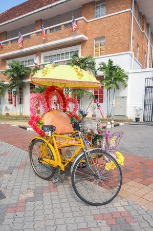 trishaw: MALACCA, MALAYSIA - OCTOBER 14: Decorative trishaw at Malacca city on Oct 14, 2015 in Malacca, Malaysia. Malacca has been listed as a UNESCO World Heritage Site since 7 July 2008.