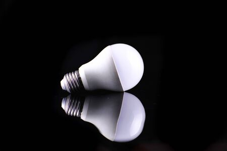 socle: Light bulb with frosted glass isolated on black