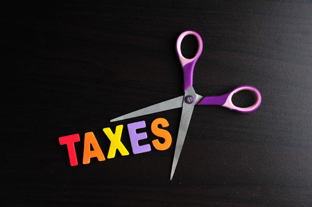 exemption: scissors and the alphabet TAXES Stock Photo