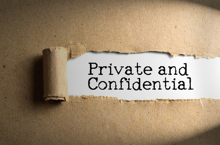 covert: Torn paper with word Private and Confidential