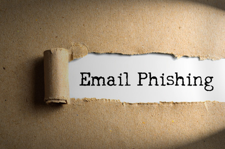 phishing: Torn paper with word Email Phishing