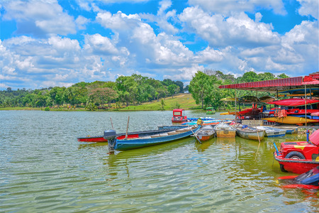 city park boat house: Boat on the lake with green nature background Stock Photo