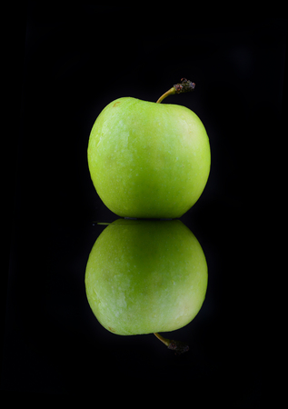 Green apple isolated on a black background