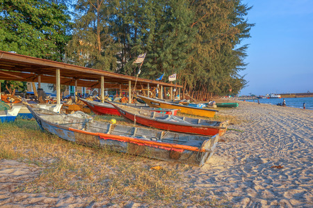 MALACCA, MALAYSIA - 2 April 2016 - Fishermen boats at the beach. Fishermen are the main occupation for villagers at Malacca village, Malaysia