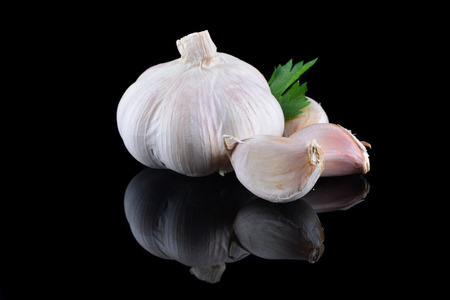 Garlic with reflection on black background