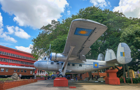 malaya: MALACCA, MALAYSIA - 5 MARCH : Visitors view historic aircraft on March 5, 2016 at Melaka, Malaysia. Airplane used by first Prime Minister of Malaysia in 1954 to seek independence for Malaya Editorial