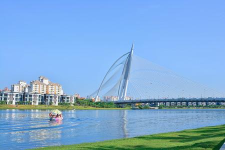 PUTRAJAYA, MALAYSIA - MARCH 13: Seri Wawasan Bridge on March 13, 2016 in Putrajaya. It is a 370m long bridge which is built across the Putrajaya Lake in Putrajaya, Malaysias federal administrative centre Editorial