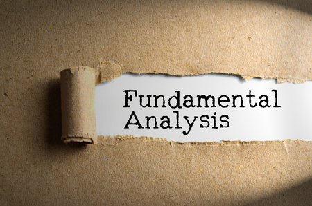 Torn paper with word FUNDAMENTAL ANALYSIS. Conceptual Images