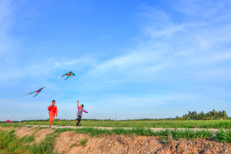 Malaysian muslim boy playing with a kite on Independence day