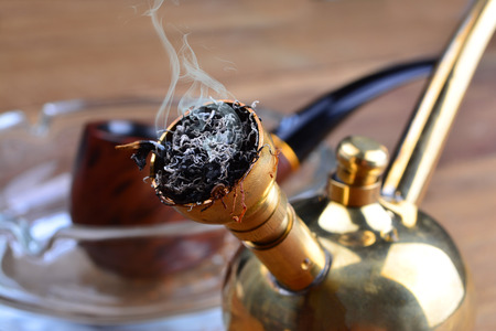 Hookah Coppery Smoking Filter with Tobacco Pipe on wooden tables