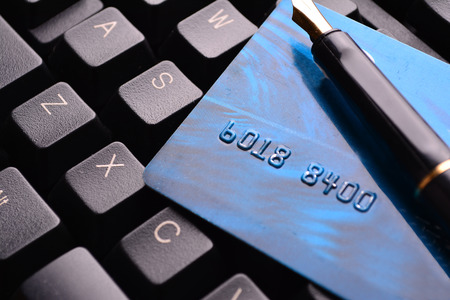 creditcard: Credit card and fountain pen on a laptop. Selective focus, soft focus and shallow depth of fields - DOF