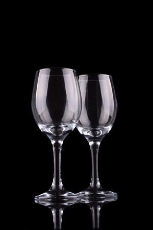 bar ware: Empty wine glass isolated on black