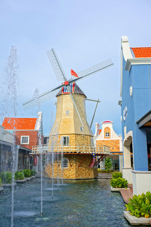 freeport: MALACCA, MALAYSIA - 21 SEPTEMBER 2016 - Replica of old dutch windmill in Freeport Premium Outlet, located at Malacca, Malaysia