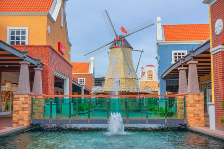 water mill: MALACCA, MALAYSIA - 21 SEPTEMBER 2016 - Replica of old dutch windmill in Freeport Premium Outlet, located at Malacca, Malaysia