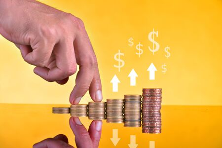 Coins stand vertically in columns ascending,revenue growth concept