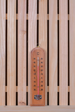 termometer: Thermometer on the wood table