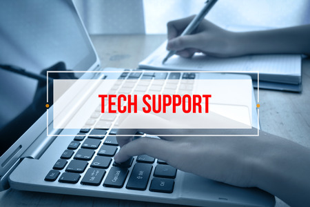 tech support: Hand Typing on keyboard with text TECH SUPPORT