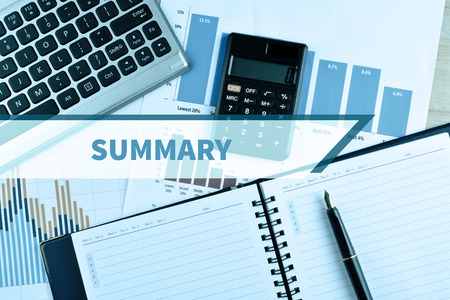 compendium: Notebook and Laptop with graph and charts. Financial Concept with word Summary