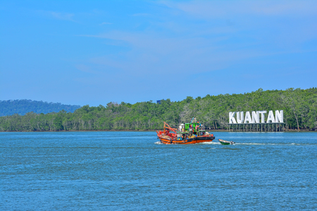 KUANTAN, MALAYSIA - 5 SEPT : An old, rusty fishing trawler returning to harbor on 5 September 2016. Kuantan is the main city for Pahang, Malaysia