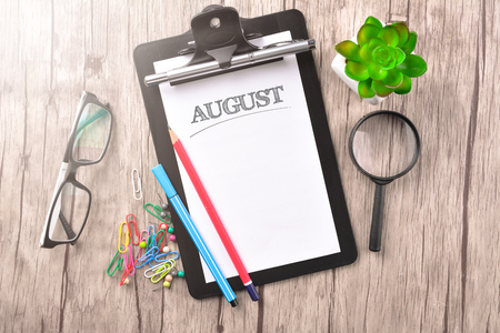 Clipboard with text written on paper - Calendar Stock Photo