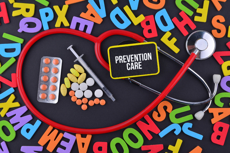 Pills, Syringe and Stethoscope with alphabet and text Prevention Care