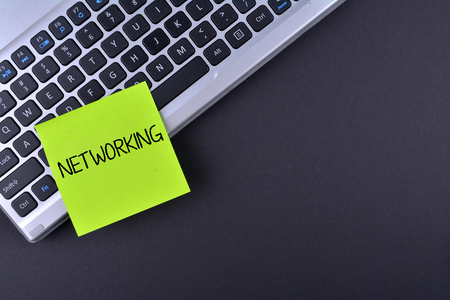 metadata: Sticky note on keyboard with text NETWORKING Stock Photo