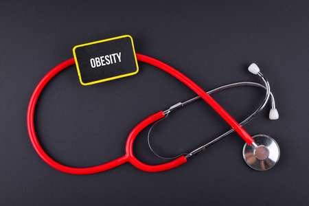 Stethoscope on black background with text. MEDICAL CONCEPT