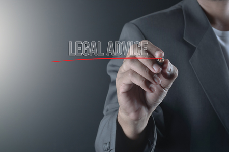 Hand of business man write or writing LEGAL ADVICE Stock Photo